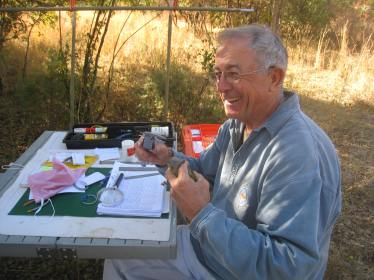 Mike Ford in his 'field office' recording details of a feisty Grey-headed Bushshrike, which had nipped his finger.